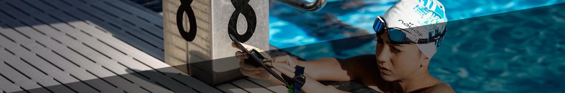 Нарукавники і жилети для плавання